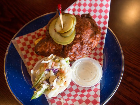 """Music City Hot Chicken, located at 111 W. Prospect Road, serves a chicken breast doused with the restaurant's """"flammable solid"""" sauce. The sauce is a mixture of Carolina reaper and Ghost chili peppers."""