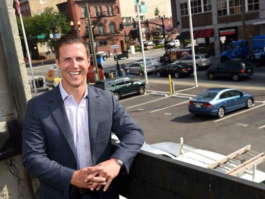 Premier Parking CEO Ryan Chapman at a parking lot that