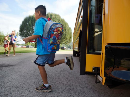 A student gets off the bus on the first day of school at Liberty Elementary August 5, 2016 in Franklin. Families that live in Hadden Hall wanted their neighborhood to move to the WIlliamson County Schools district so their children could attend Clovercloft Elementary instead of Liberty.