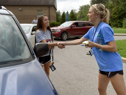 University of Southern Indiana resident assistant Bree Wilzbacher of Haubstadt greets freshman Jordanne Stichter of Goshen as she moves into Ruston Hall during Welcome Week on campus Thursday.