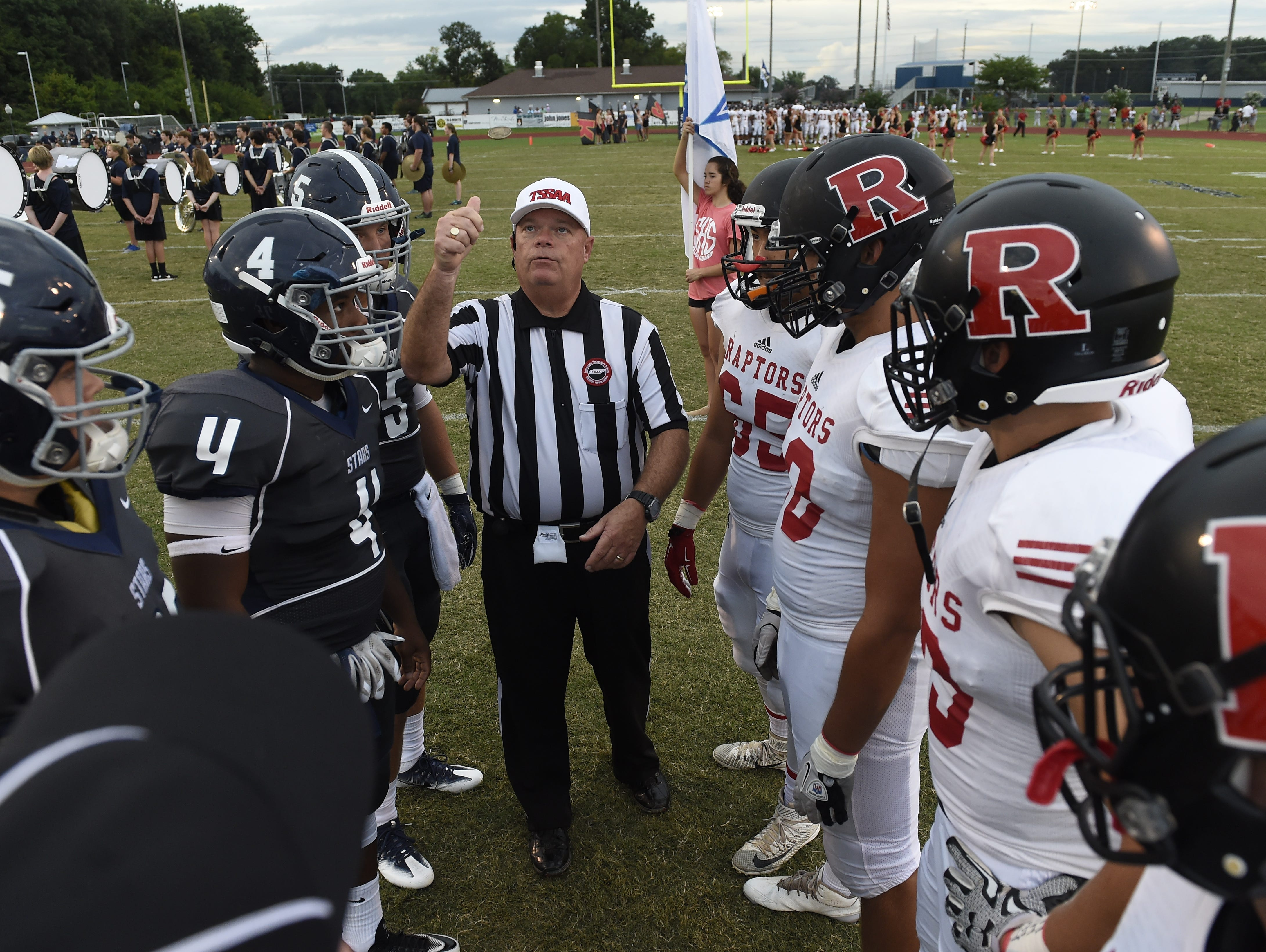 The referee flips the coin before the start of the Ravenwood against Siegel game at Siegel High on Thursday in both teams' season opener.