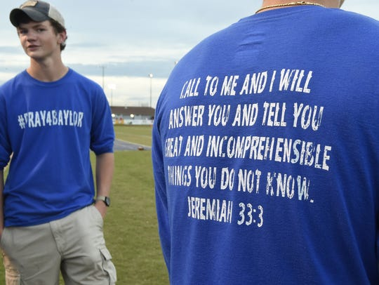 Friends of Baylor Bramble wear T-shirts to show support