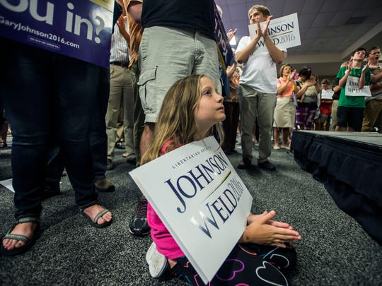 Mylie Benjamin, 9, of Essex Junction listens to Libertarian candidate for president Gary Johnson at the Sheraton Hotel in South Burlington Wednesday night.