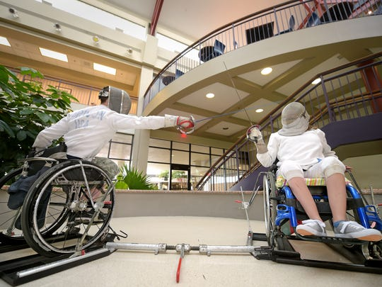 Joey Brinson, left, and Gracelyn Thraikill, 12,  practice fencing at Methodist Rehabilitation Center Tuesday. Brinson is set to compete in Rio for his second straight Paralympic Games.