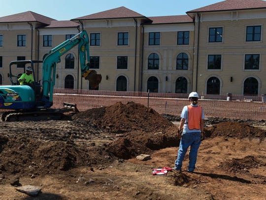 Archaeologists search a site at Aquinas College on