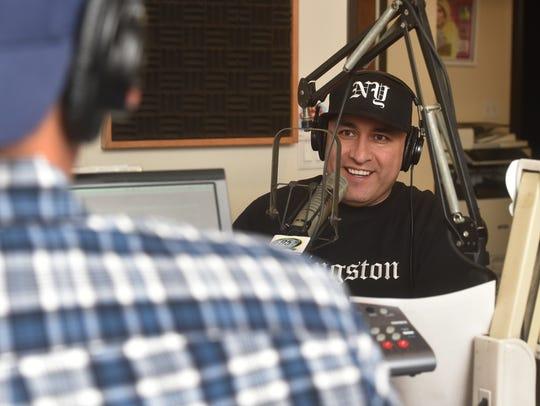 "Daniel ""Mambo"" Herrejon jokes with Q95.9 FM co-host"