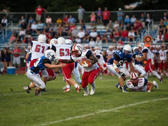 Red Land's Justin Johnson (6) carries the ball during