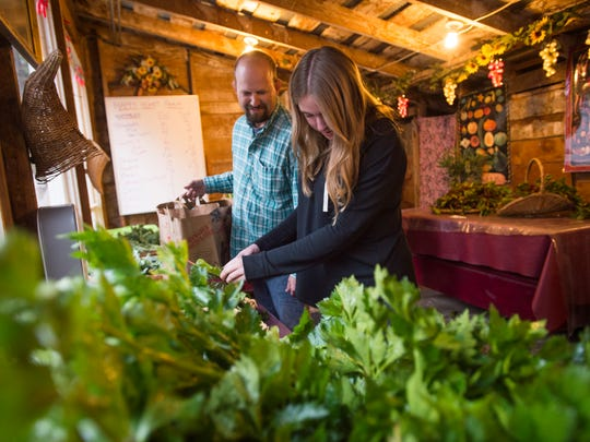 Toby and Reese Loughrige pick out vegetables for their CSA share at Happy Heart Farm Tuesday in west Fort Collins. Farm owners Dennis and Bailey Stinson are retiring at the end of the growing season and plan to subdivide their 20-acre property.
