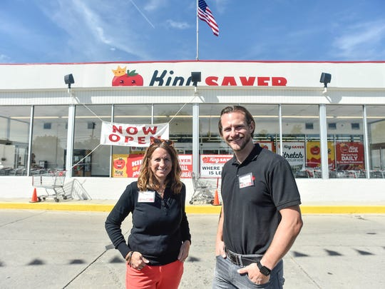 Brother and sister team Julie Anderson and Mike Needler Jr. pose for a portrait in front of their new grocery store King Saver, located in the same building the Community Market previously occupied.