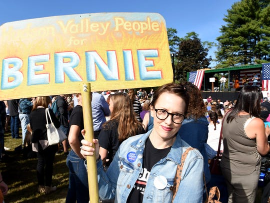 Karen Locker of Rhinebeck holds a sign she brought to the Democratic National Convention which reads 'Hudson Valley People for Bernie' at Friday's Zephyr Teachout rally in New Paltz.