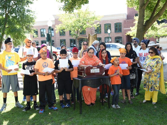 "Members of the Sikh congregation in Canton sing a beautiful song whose main theme is, "" In Your Grace, we experience ultimate Peace!"" during the International Day of Peace event held Sunday in Plymouth."