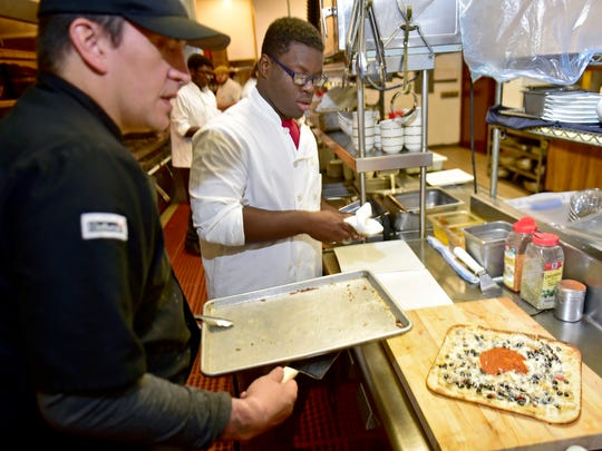Michael Kalathas, left, owner of The Orchards Restaurant, Chambersburg, works in the kitchen with Philippe Lozius on Tuesday, September 20, 2016. A Food Service and Food Wellness Academy designed to teach CASHS and Career Magnet school students about the different aspects of the food industry.