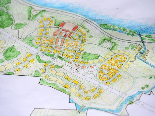 A proposed building plan and lot layout shows the different types of living experiences planned for Olivette, an agrihood community, along the French Broad River.