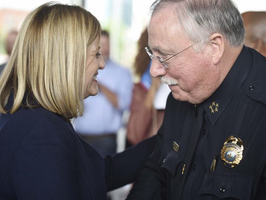"""Mayor Megan Barry, left, talks with Metro Police Chief Steve Anderson before she holds her first """"State of Metro"""" address as mayor at Ascend Amphitheater April 29, 2016."""