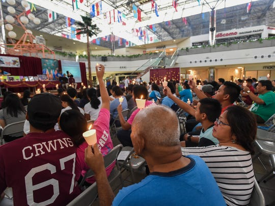 Attendees hold lit candles during the 12th Annual Lifeworks Guam Candlelight Memorial Service at the Micronesia Mall in this file photo.