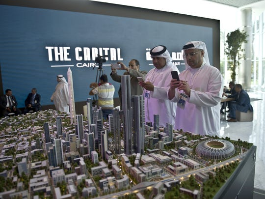 A delegation looks at a scale model of the new Egyptian