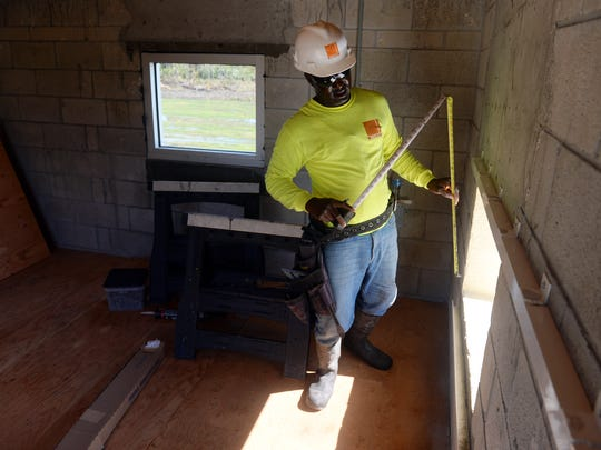 Filocles Theophile, an employee with West Construction,