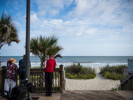 Pedestrians admire the view of the beach from the boardwalk Wednesday Oct. 5, 2016 in Myrtle Beach.