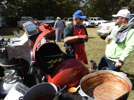 Keith Parker of Monoroe, Louisianna, left, talks about his cooking with Mountain Home resident Matt Novy, right,  Saturday during the 20th Annual Hillbilly Chili Cook-off. Parker spoke with Novy about barbecue and cooking ideas.