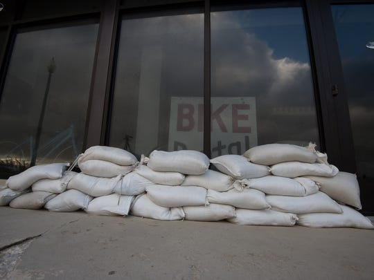 View of sand bags in front of Atlantic Cycles store in Rehoboth Beach.