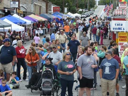 Attendees at the 71st annual Turkey Trot Festival fill the streets in downtown Yellville in 2016. The 73rd Turkey Trot will be held this Friday and Saturday.