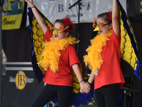 Two young performers entertain the crowd during the lip sync competition at the 71st Turkey Trot Festival in Yellville. The long-running Marion County festival returns this weekend.