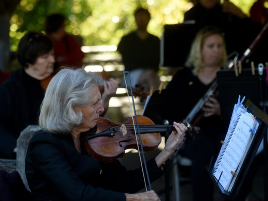 Members of Richmond Community Orchestra, including Laara Delain, foreground, perform Oct. 8 during the annual City Life celebration at Glen Miller Park in Richmond.