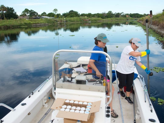 Ocean Research & Conservation Association researchers Chloe Lloyd, left, and Retta Rohm collect water and sediment samples Sept. 29, 2016, from muck traps deployed in the C-24 Canal to determine which nutrients are most prevalent in the muck.