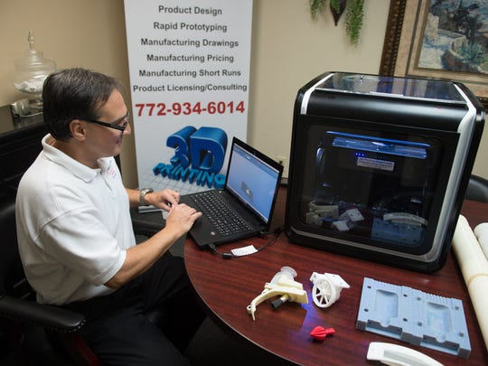 Anthony DiChiara works on his computer and 3-D printer at his office in Stuart.