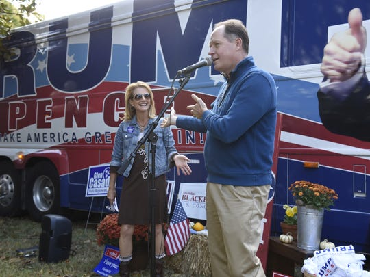 Sen. Jack Johnson and Williamson County Republican Party Chairman Julie Hannah address a crowd outside the Trump campaign bus in 2016. While Johnson said he supports requiring party registration for primary voters, others have pointed out how open primaries may have contributed to Trump's win in the national GOP primary.