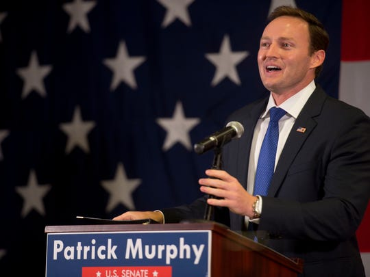 U.S. Rep Patrick Murphy, seen in this file photo celebrating his primary victory Aug. 30, 2016, and his Republican opponent, Sen. Marco Rubio, have released several ads attacking one another this election season.