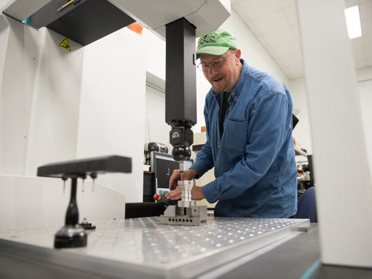 Quality technician Phil Moegenburg checks a component at Advanced Machine & Tool in Fort Pierce. The company provides high-precision machine shop services for utilities, energy and amusement park companies.