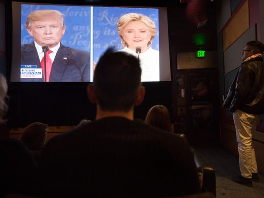 People watch the final presidential debate at the Lyric Cinema Cafe in Fort Collins on Oct. 19.
