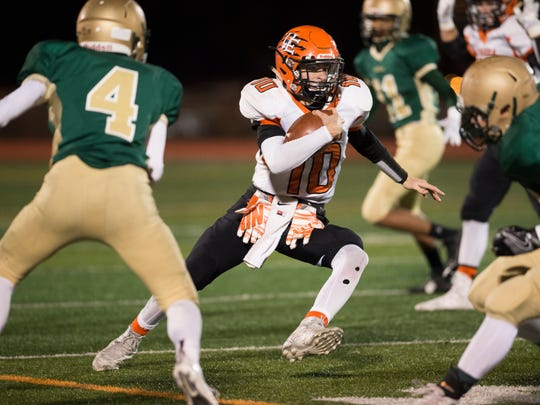 Union-Endicott quarterback Devon Hogan rushes the ball during the second quarter of the Section 4 Class A final on Friday, Nov. 4, 2016.