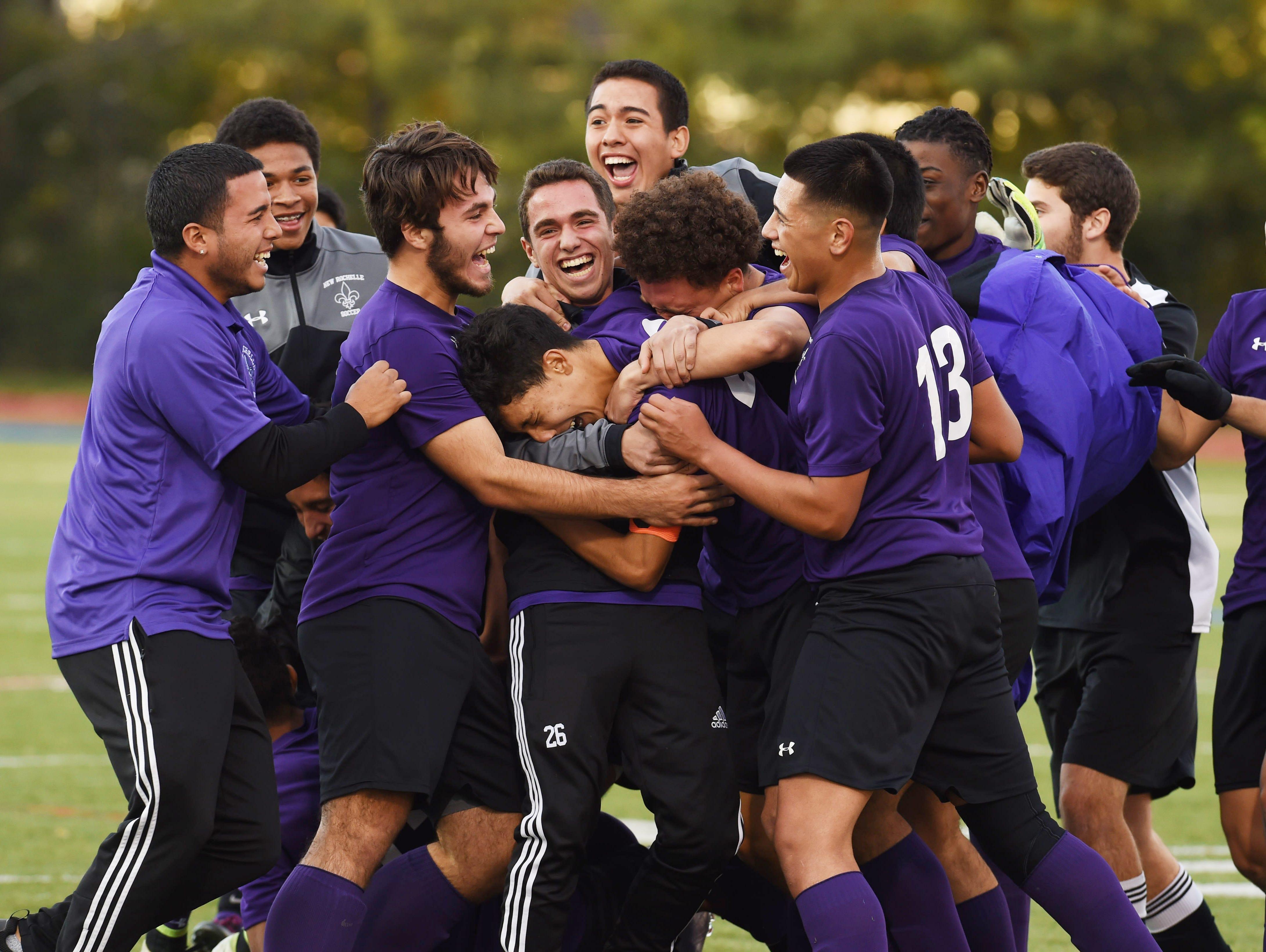 New Rochelle's boys soccer team celebrates after winning Saturday's Class AA regional final against Newburgh.