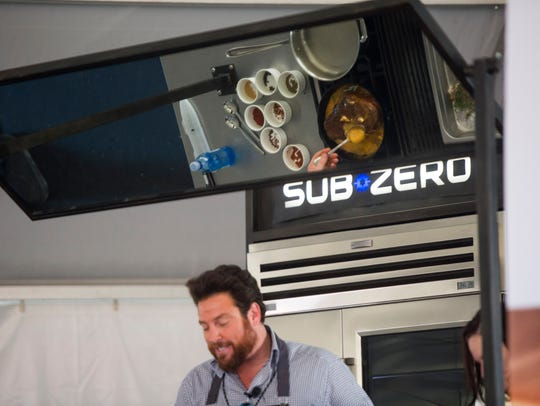 Chef Scott Conant gives a culinary demonstration during