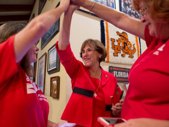 Rep. Gayle Harrell (center), celebrates her victory