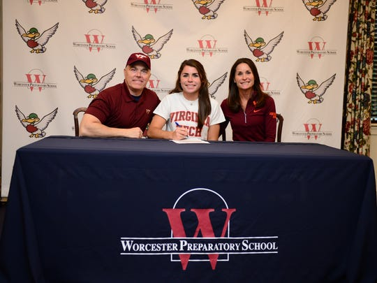 Worcester Preparatory School student athlete Leigh Lingo,  with her parents Derrick and Ann, sign her letter of intent on Nov. 9, 2016 to attend Virginia Tech in the fall of 2017 to play Lacrosse.