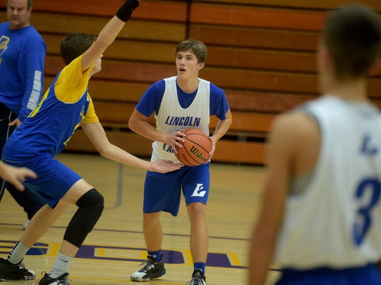 Lincoln High School boys basketball players practice