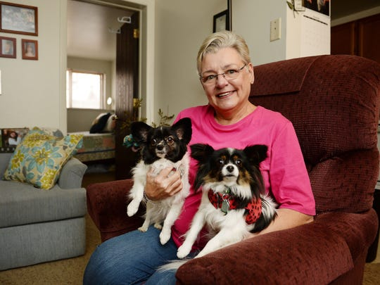 Ann Green, with her papillons Bella, left, and Mystic.