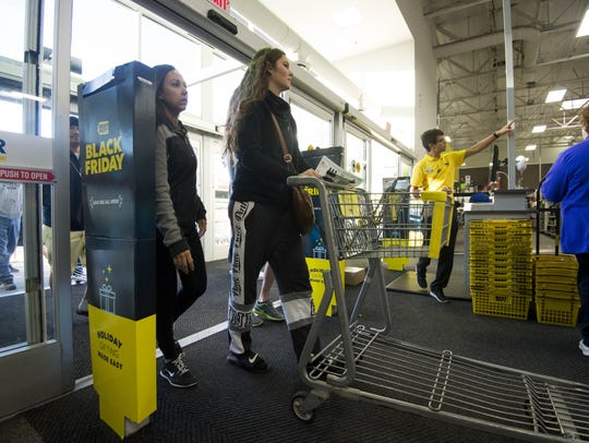 Shoppers enter the store for Black Friday shopping