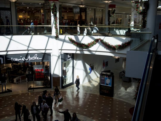 Shoppers make their way through the mall during Black