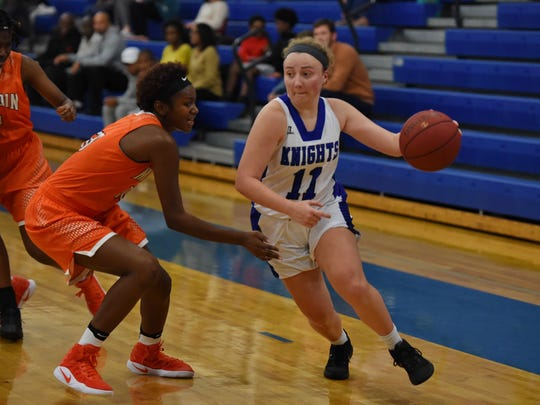 Maeve McNamara (11) of St. Joseph's drives the left baseline during the Knights' 57-32 loss to visiting Mauldin Tuesday night. McNamara surpassed 1,000 points for her career in the game.