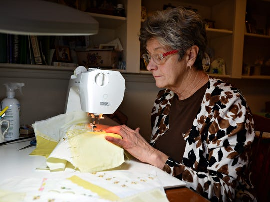Linda Hopkins sews at her home on Tuesday, November 29, 2016. Hopkins stays busy in retirement with a small sewing business, a job at Home Goods and volunteering for the library.