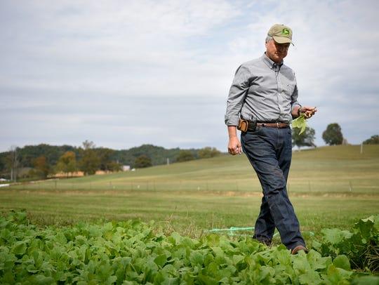 Lt. Gov. Ron Ramsey checks the vegetable garden at