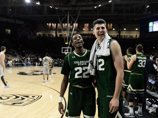Nov 30, 2016; Boulder, CO, USA; Colorado State Rams guard J.D. Paige (22) and forward Nico Carvacho (32) celebrate the win over the Colorado Buffaloes in the second half at Coors Events Center. The Rams defeated the Buffaloes 72-58. Mandatory Credit: Ron Chenoy-USA TODAY Sports