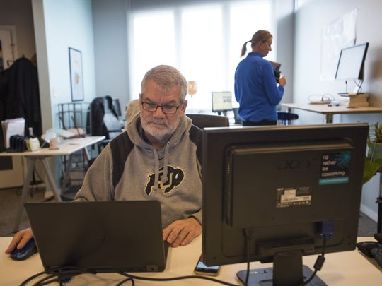 Andy Brown works on his laptop at Cohere Co-working on Friday, December 2, 2016. The space allows an office environment for freelancers and small companies or startups.