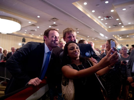 Congressman Patrick Murphy takes a selfie with supporters Nov. 8, 2016, at the Palm Beach Gardens Marriott.