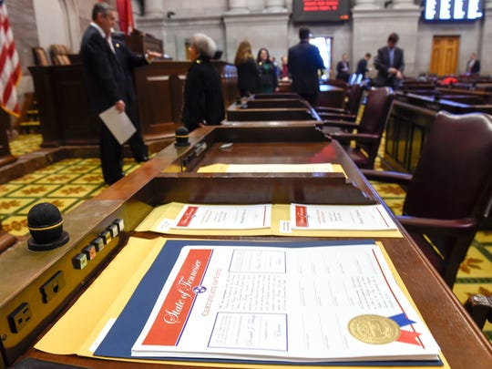 The State of Tennessee Certificate of Vote sits on one of the eleven delegates desk waiting to be signed on Monday, Dec. 19, 2016 at the Tennessee House of Representative Chamber in Nashville, Tenn.