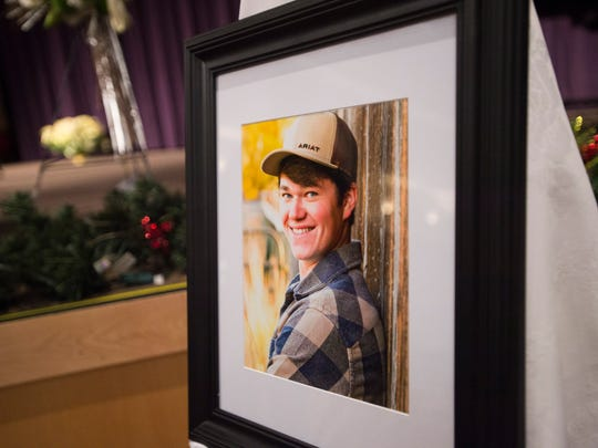 A photo of Jack Headley sits near his casket during the Windsor High School student's funeral at Timberline Church Tuesday, December 20, 2016. Headley's death is the latest in a string of tragedies that have affected the young people in the Windsor community.